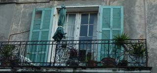 Worn building balcony-1